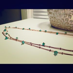 Double stranded long gold and teal beaded chain